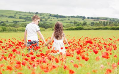 A family photo-shoot in the poppy fields.